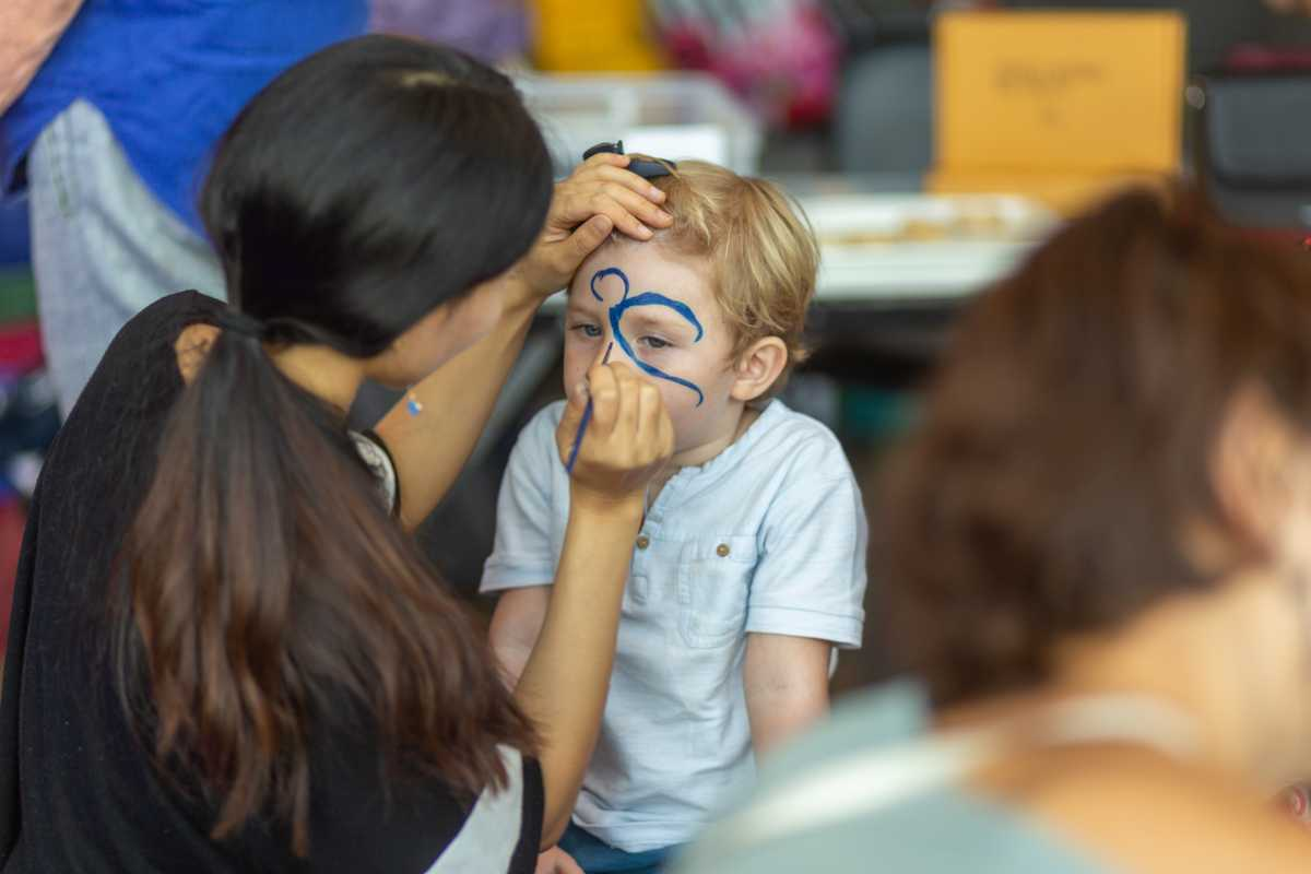 a child having his face painted