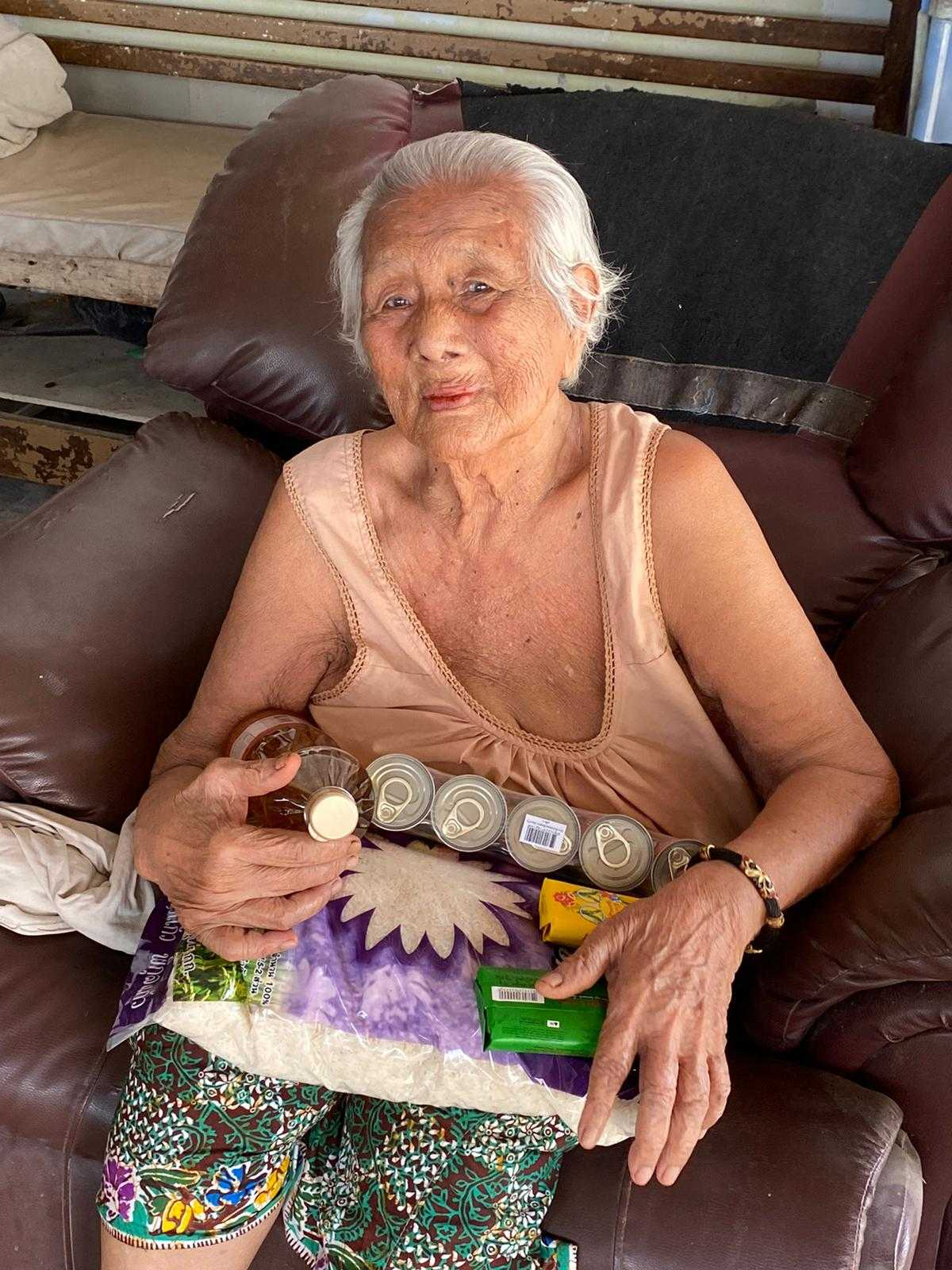 an elderly woman with food parcel